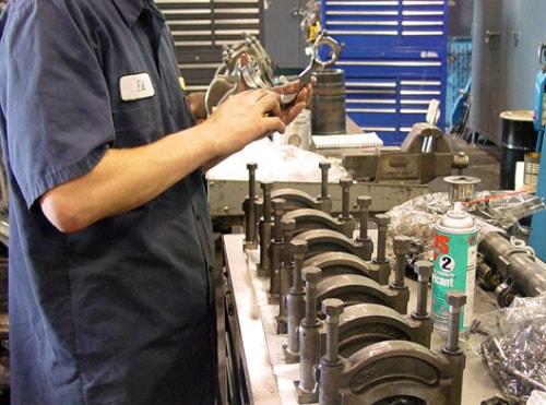 mechanic working on diesel engine